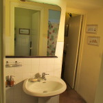 ante-bathroom with bathroom and shower in the mirror